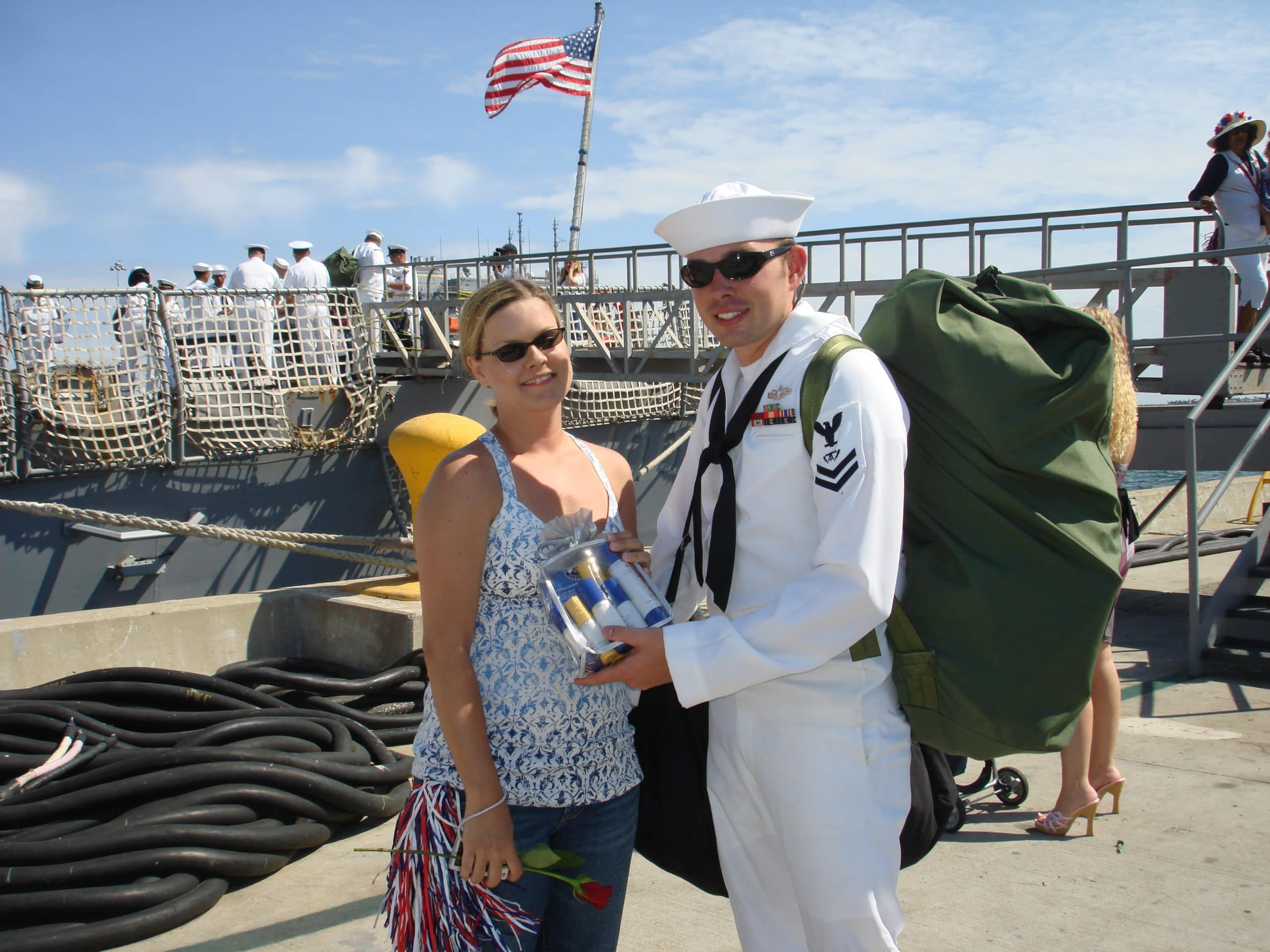 A sailor presents a luxury skincare set to his wife.