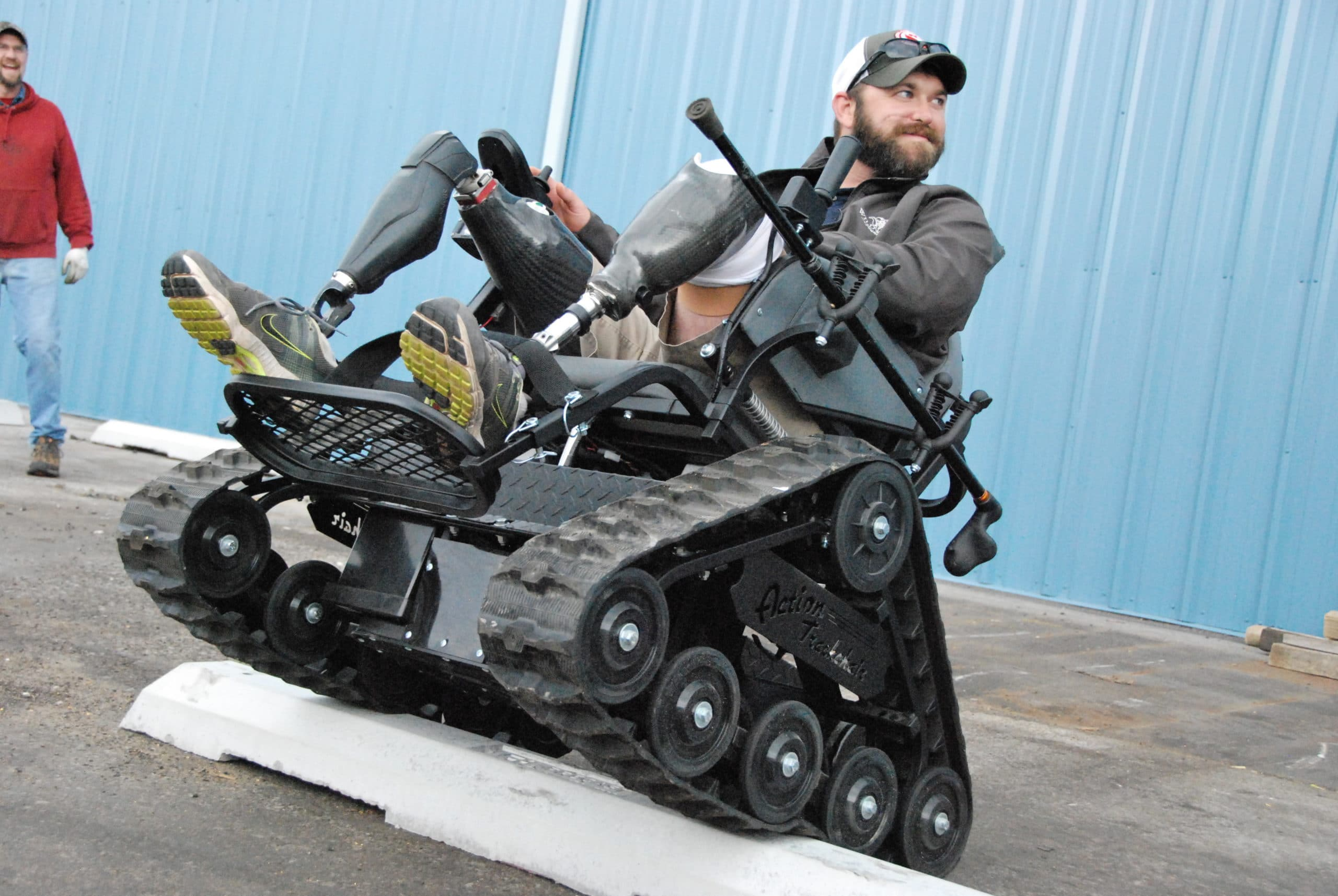 Matt Amos negotiates an obstacle after receiving a trackchair from Freedom Alliance.