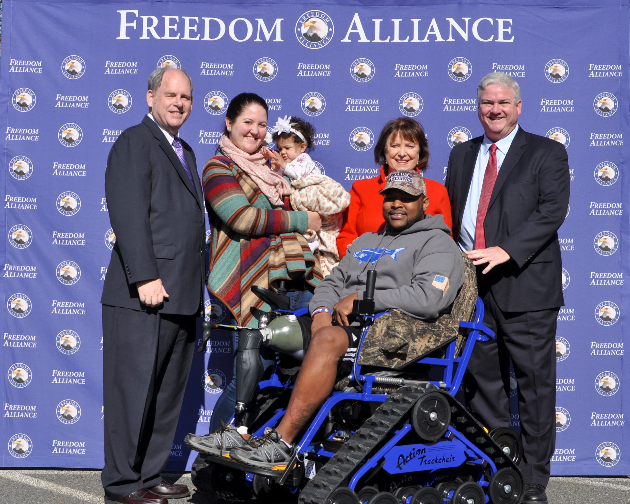 Jeramie Green and his family during his trackchair presentation.