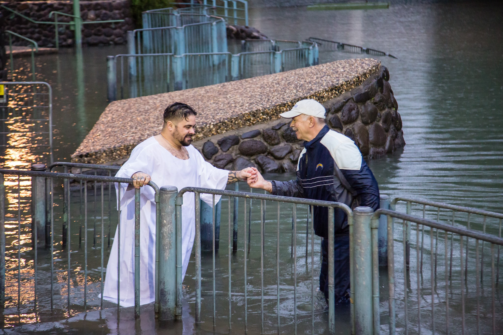 A participant in the Freedom Alliance Israel Tour is baptized in the Jordan River